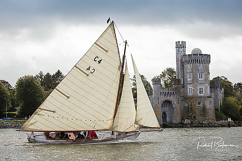 The Golden Oldie comes to town. The restored 1898 Cork Harbour One Design Jap, raced by Royal Cork Admiral Colin Morehead, reaches the finish of the Cobh-Blackrock Race. The CHODs are renowned for their pleasant steering characteristics - even on this gusty day, Jap's tiller is still in a very manageable fore-and-after position.  Photo: Robert Bateman