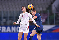 Swiss Riola Xhemaili (18) and French Charlotte Bilbault (14) pictured during the 2nd Womens International Friendly game between France and Switzerland at Stade Saint-Symphorien in Longeville-lès-Metz, France.