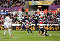 SWANSEA, WALES - MAY 17: Bafetimbi Gomis of Swansea (2nd L) takes a header during the Premier League match between Swansea City and Manchester City at The Liberty Stadium on May 17, 2015 in Swansea, Wales. (photo by Athena Pictures/Getty Images)