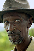 Rwanda. Southern province. Gitisi village. Portrait of a black man with hat, a Tutsi survivor of the 1994 Genocide.  © 2007 Didier Ruef