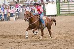 Woman barrel racing, Jordan Valley Big Loop Rodeo, Ore.