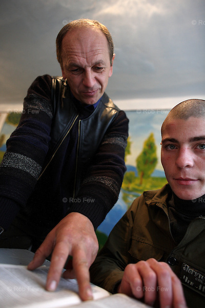 Here, a teacher offers guidance to one of the students.<br /> <br /> These are the boys of Berezhany - prisoners in one of Ukraine's 10 juvenile detention centres. This a model facility where children are kept separately from adults and where their health and educational needs are taken care of. For the majority of Ukraine's prisoners, however, including most of the children who are not kept here, conditions are far worse.
