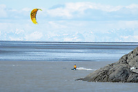 Kite boarders enjoy heavy winds along Turnagain Arm, south of Anchorage.