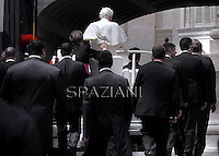 Pope Benedict XVI leaves onthe Popemobile surrounded by Vatican gendarmes after his audience to the group renewal in the spirit in Saint Peter's Square at the Vatican on May 26, 2012.
