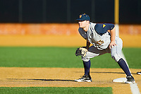 West Virginia Mountaineers first baseman Ryan McBroom (13) on defense against the Wake Forest Demon Deacons at Wake Forest Baseball Park on February 24, 2013 in Winston-Salem, North Carolina.  The Demon Deacons defeated the Mountaineers 11-3.  (Brian Westerholt/Four Seam Images)
