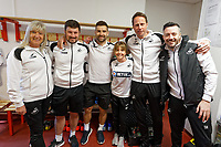 Suzan Eames Football Utilities Co-ordinator, Michael Eames, Jordan Smith, Adele Calaghan, Jez Dr. Jez McCluskey, Club Doctor and Scott Helmich in the changing room prior to the Sky Bet Championship match between Nottingham Forest and Swansea City at City Ground, Nottingham, England, UK. Saturday 30 March 2019