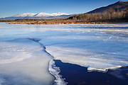 Snowcapped Presidential Range from Cherry Pond at Pondicherry Wildlife Refuge in Jefferson, New Hampshire USA. The Presidential Range Rail Trail (Cohos Trail) passes by Cherry Pond. Designated a National Natural Landmark in 1974 by the National Park Service, Pondicherry Wildlife Refuge is located in the towns of Jefferson and Whitefield, New Hampshire.