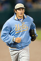 UCLA pitcher Trevor Bauer heads to the bullpen during Game Two of the NCAA Division One Men's College World Series Finals on June 29th, 2010 at Johnny Rosenblatt Stadium in Omaha, Nebraska.  (Photo by Andrew Woolley / Four Seam Images)
