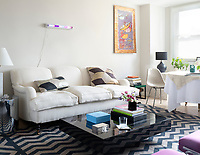 Lauren is obsessed with her George Smith sofa, but knew she needed something edgy to breakup the English stuffiness. With Interior Designer Lili Diallo in tow, the pair found this low, black lacquered Willy Rizzo coffee table. The furniture is grounded by a vegetable-dye dhurrie with a graphic zig zag pattern.