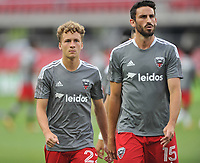 WASHINGTON, DC - JULY 7: Steven Birnbaum #15 of D.C. United with Griffin Yow #22 of D.C. United  warming up during a game between Liga Deportiva Alajuense  and D.C. United at Audi Field on July 7, 2021 in Washington, DC.