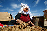 Palestinian Latifa al-Najjar makes clay ovens for sale in Khan Yunis in the southern Gaza Strip on March 5, 2020. - Al-Najjar has been practicing her craft for 30 years, using clay and wheat straw to make clay ovens which she then sells for the equivalent of 28 USD each. Photo by Osama Baba