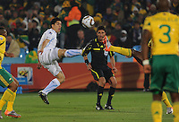 Uruguay's Luis Suarez conteests for a loose ball under the watchful eye of  Swiss referee Massimo Busacca. Uruguay defeated South Africa, 2-0, in both teams' second match of play in Group A of the 2010 FIFA World Cup. The match was played at Loftus Versfeld in Pretoria, South Africa June 16th.