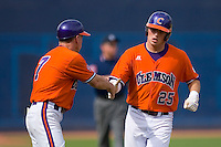 Kyle Parker #25 of the Clemson Tigers is congratulated by Clemson Tigers head coach Jack Leggett #7 after hitting a home run at Durham Bulls Athletic Park May 22, 2009 in Durham, North Carolina.  (Photo by Brian Westerholt / Four Seam Images)