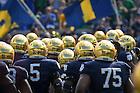 September 24, 2016; The football team takes the field for the game against Duke. (Photo by Matt Cashore)
