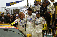 As Ron Fellows waits in the car for the clock to tick closer to one, teamates Johnny O'Connell, Chris Keifel and Franck Freon pose for pictures next to the soon to be victorious car..39th Rolex 24 at Daytona, 3/4 February,2001 Daytona International Speedway  Daytona Beach,Florida,USA.©F.Peirce Williams 2001 ..