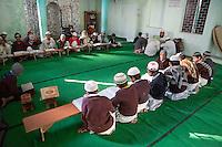 Madrasa Students Studying in Mosque with Imam, Madrasa Imdadul Uloom, Dehradun, India.