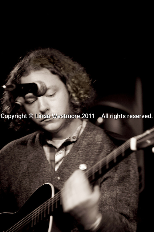 Adam Hoskins, guitar and vocals.  American group, Pokey LaFarge and the South City Three, play riverboat soul at the Blue Coconut Club, Pulborough, Sussex.