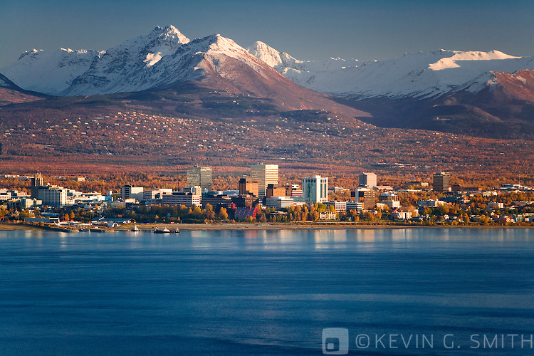 Aerial view of Anchorage, looking to the south with the Chugach Mountain Range behind it, fall foliage, sunset, Anchorage, Alaska, USA.