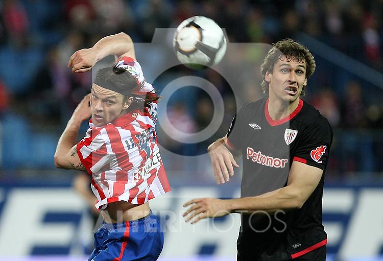Atletico de Madrid's Tomas Ujfalusi (l) and Athletic de Bilbao's Fernando LLorente during La Liga match. March 26, 2010. (ALTERPHOTOS/Acero)