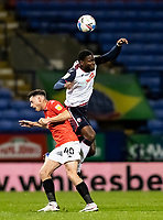 Bolton Wanderers' Ricardo Santos (right) competing with Salford City's Ian Henderson<br /> <br /> Photographer Andrew Kearns/CameraSport<br /> <br /> The EFL Sky Bet League Two - Bolton Wanderers v Salford City - Friday 13th November 2020 - University of Bolton Stadium - Bolton<br /> <br /> World Copyright © 2020 CameraSport. All rights reserved. 43 Linden Ave. Countesthorpe. Leicester. England. LE8 5PG - Tel: +44 (0) 116 277 4147 - admin@camerasport.com - www.camerasport.com