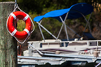 Bright red life preserver rings on standby, ready if needed at the Lake Chabot Marina in Castro Valley, California.