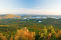 The whole of Squam Lake and beyond is featured in this early autumn landscape.