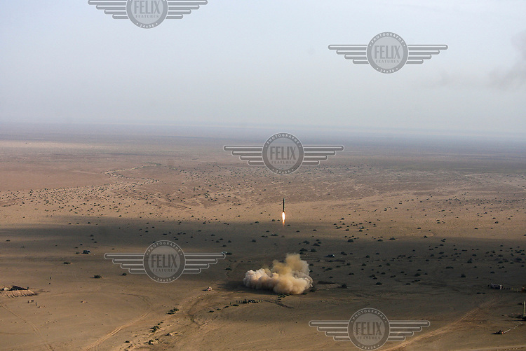Iran's Revolutionary Guards fire a Shahab-2 long-range ballistic missile during the first phase of military manoeuvres in the central desert.