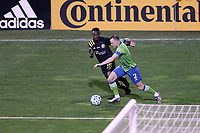 COLUMBUS, OH - DECEMBER 12: Brad Smith #2 of the Seattle Sounders FC is defended by Harrison Afful #25 of the Columbus Crew during a game between Seattle Sounders FC and Columbus Crew at MAPFRE Stadium on December 12, 2020 in Columbus, Ohio.