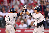 New York Yankees outfielder Curtis Granderson #14 greets teammate  Alex Rodriguez #13 after Rodriguez's home run against the Los Angeles Angels at Angel Stadium on June 4, 2011 in Anaheim,California. Larry Goren/Four Seam Images