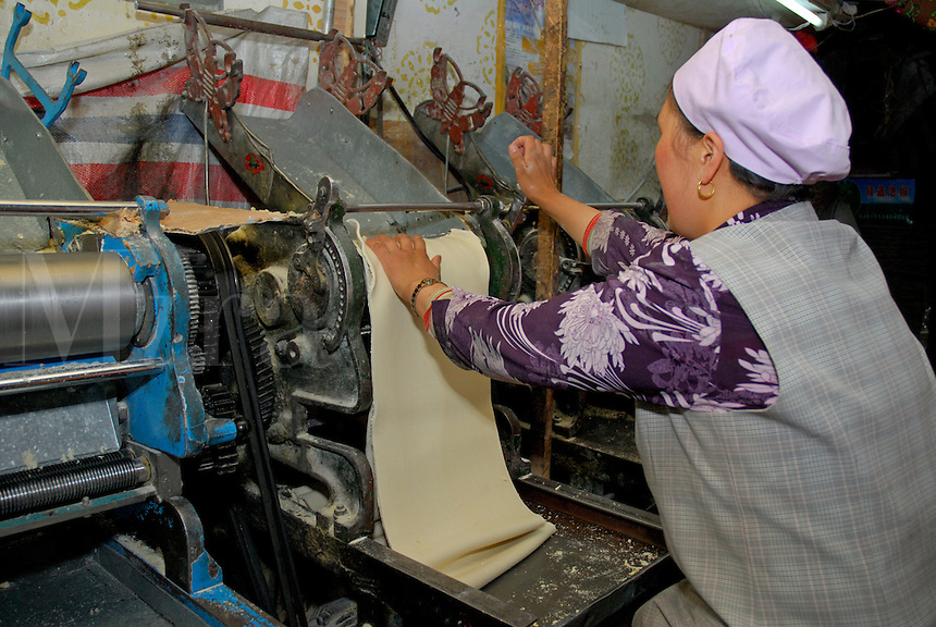 Tibetan noodle maker in an alleyway off the Dekyi Shar Lam, or East Beijing Road, Lhasa, Tibet.