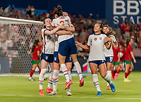 HOUSTON, TX - JUNE 10: Christen Press #23 and Samantha Mewis #3 of the USWNT celebrate a goal during a game between Portugal and USWNT at BBVA Stadium on June 10, 2021 in Houston, Texas.