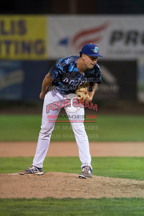 Ogden Raptors relief pitcher Reza Aleaziz (43) looks in for the sign during a Pioneer League game against the Billings Mustangs at Lindquist Field on August 17, 2018 in Ogden, Utah. The Billings Mustangs defeated the Ogden Raptors by a score of 6-3. (Zachary Lucy/Four Seam Images)