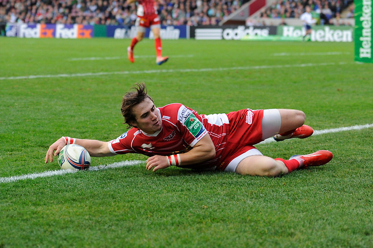 Rhodri Williams of Scarlets makes the ball safe during the Heineken Cup Round 1 match between Harlequins and Scarlets at the Twickenham Stoop on Saturday 12th October 2013 (Photo by Rob Munro)
