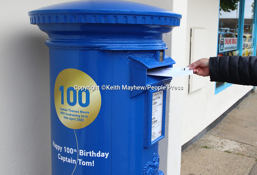 Royal Mailcelebrated Captain Tom Moore's 100th birthday with a special postbox in honour of his incredible efforts to raise money for the NHS.<br /> The postbox is painted NHS blue and includes a gold balloon and birthday greetings in honour of Captain Tom.<br /> His fantastic fundraising efforthas reached the £32 million mark for the NHS, and he has become a symbol of hope and unity across the UK and beyond during these uncertain times. Marston Moretaine, Bedford. May 3rd 2020<br /> <br /> Photo by Keith Mayhew