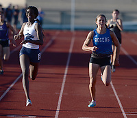 Kinleigh Hall (left) of Har-Ber pulls ahead Friday, April 30, 2021, of Grace Lueders of Rogers to win the 400 meters during the 6A-West Conference Track and Field Meet at the Tiger Athletic Complex in Bentonville. Visit nwaonline.com/210501Daily/ for today's photo gallery. <br /> (NWA Democrat-Gazette/Andy Shupe)