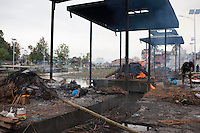A man cremates a dead body on a burning ghat near Pashupati Nath temple in Kathmandu, Nepal