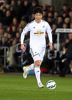 SWANSEA, WALES - MARCH 16: Ki Sung Yueng of Swansea<br /> Re: Premier League match between Swansea City and Liverpool at the Liberty Stadium on March 16, 2015 in Swansea, Wales
