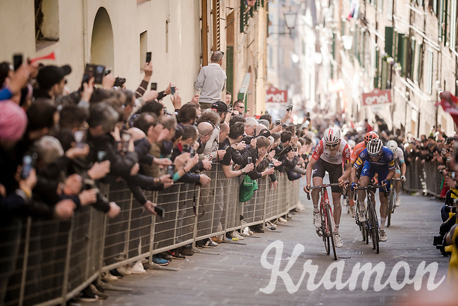 defending race champion Tiesj Benoot (BEL/Lotto-Soudal) ahead of other former winner Zdeněk ŠTYBAR (CZE/Deceuninck-Quick Step) on the final infamous city climb in the narrow streets of Siena, just 500m before the finish. Fighting for 4th place this time around.<br /> <br /> 13th Strade Bianche 2019 (1.UWT)<br /> One day race from Siena to Siena (184km)<br /> <br /> ©kramon