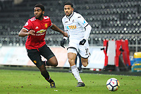 Sunday 18 March 2018<br /> Pictured:  Kenji Gorre of Swansea City is marked by Ro Shaun Williams of Manchester United<br /> Re: Swansea City v Manchester United U23s in the Premier League 2 at The Liberty Stadium on March 18, 2018 in Swansea, Wales.