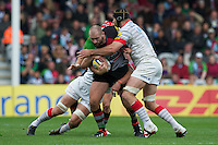 Joe Marler of Harlequins is tackled by Steve Borthwick of Saracens during the Aviva Premiership match between Harlequins and Saracens at the Twickenham Stoop on Sunday 30th September 2012 (Photo by Rob Munro)