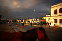 Children play stick ball in the streets of Cienfuegos, Cuba on 15 March 2009.