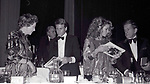 Myrna Loy, Ryan O'Neal, Farrah Fawcett and George Barrie attends  the Friars Club honored Cary Grant as their Man of the Year on May 16, 1982 at the Waldorf Astoria in New York City.