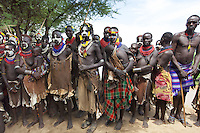 Ethiopia. Southern Nations, Nationalities, and Peoples' Region. Omo Valley. Korcho Village. Kara tribe. Agro-pastoralist group. The Kara men and women are best known for the elaborate body painting they indulge in before important ceremonies. They paint their faces and bodies in white chalk. Men and women also make an incision below their bottom lip and insert a nail, a piece of wood, a plastic straw or a feather. Scarification plays an important role in Kara body decoration. The Omo Valley, situated in Africa's Great Rift Valley, is home to an estimated 200,000 indigenous peoples who have lived there for millennia. Amongst them are 1,000 to 2,000 Karo who dwell on the eastern banks of the Omo river. Southern Nations, Nationalities, and Peoples' Region (often abbreviated as SNNPR) is one of the nine ethnic divisions of Ethiopia. 8.11.15 © 2015 Didier Ruef