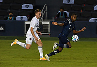 KANSAS CITY, KS - OCTOBER 07: #14 Djordje Mihailovic of Chicago Fire FC tries to catch up to #17 Gadi Kinda of Sporting Kansas City as he drives the ball upfield during a game between Chicago Fire and Sporting Kansas City at Children's Mercy Park on October 07, 2020 in Kansas City, Kansas.
