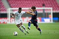 ZAPOPAN, MEXICO - MARCH 21: Andres Perea #15 of the United States straight arms Edison Azcona #10 of Dominican Republic during a game between Dominican Republic and USMNT U-23 at Estadio Akron on March 21, 2021 in Zapopan, Mexico.