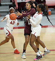 Mississippi State forward Sidney Cooks (center) and Arkansas forward Erynn Barnum (right) battle Thursday, Feb. 11, 2021, for a rebound during the first half of play in Bud Walton Arena. Visit nwaonline.com/210212Daily/ for today's photo gallery. <br /> (NWA Democrat-Gazette/Andy Shupe)