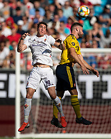 CHARLOTTE, NC - JULY 20: Shkodran Mustafi #20 and Dusan Vlahovic #29 go up for a header during a game between ACF Fiorentina and Arsenal at Bank of America Stadium on July 20, 2019 in Charlotte, North Carolina.