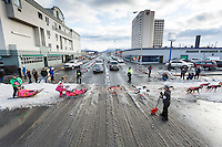 Traffic stops on 5th avenue for Iditarod musher DeeDee Jonrowe to cross in downtown Anchorage during the cermonial start day of Iditarod 2015 in Anchorage, Alaska. Saturday March 7, 2015<br /> <br /> (C) Jeff Schultz/SchultzPhoto.com - ALL RIGHTS RESERVED<br />  DUPLICATION  PROHIBITED  WITHOUT  PERMISSION