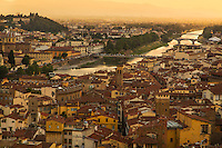 The Arno River of Florence glistens and disappears into the distance as the sun set on another hot humid day.
