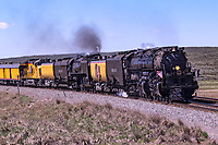 Union Pacific steam locomotives 4014, Big Boy, and 844 double-head towards Evanston, Wyoming, on their return trip to the Union Pacific Steam Shop in Cheyenne.